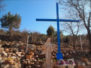 Blue Cross at the base of Apparition Hill